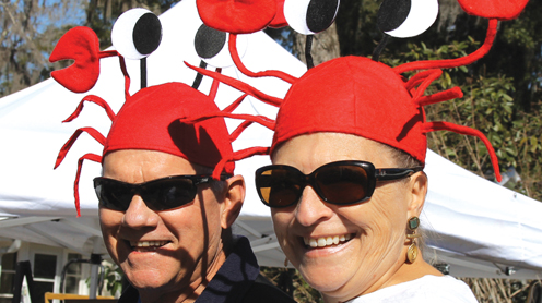 Happy faces–and fiddler crab headdresses–were the order of the day at Steinhatchee's three-day Fiddler Crab Festival.