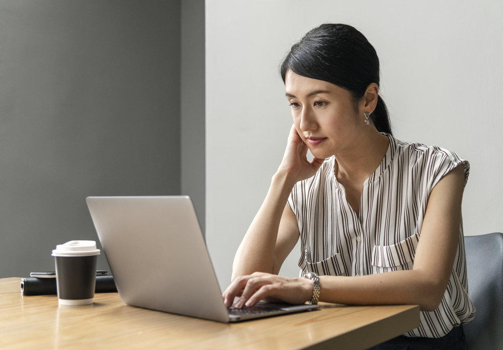 Japanese woman working on a laptop