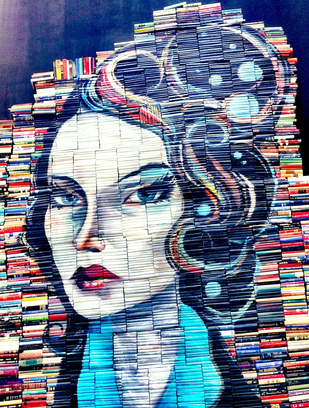 Another iPhone shot, a wonderful bookstore in Fort Bonifacio named  Fully Booked      has this amazing book mural. Ain't she a beauty, and so well read!