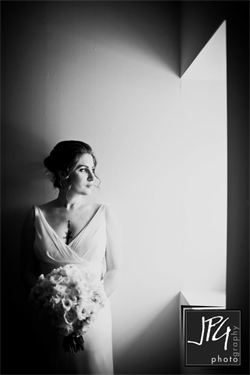 I really love this picture of Elisabeth. Marno captured the light perfectly. Elisabeth's dress accented the tattoos on her chest and back. The dress also had an intricate, 15 point French bustle. Thanks to a diagram drawn by Mia of Mia's Cleaners, we got it just right.
