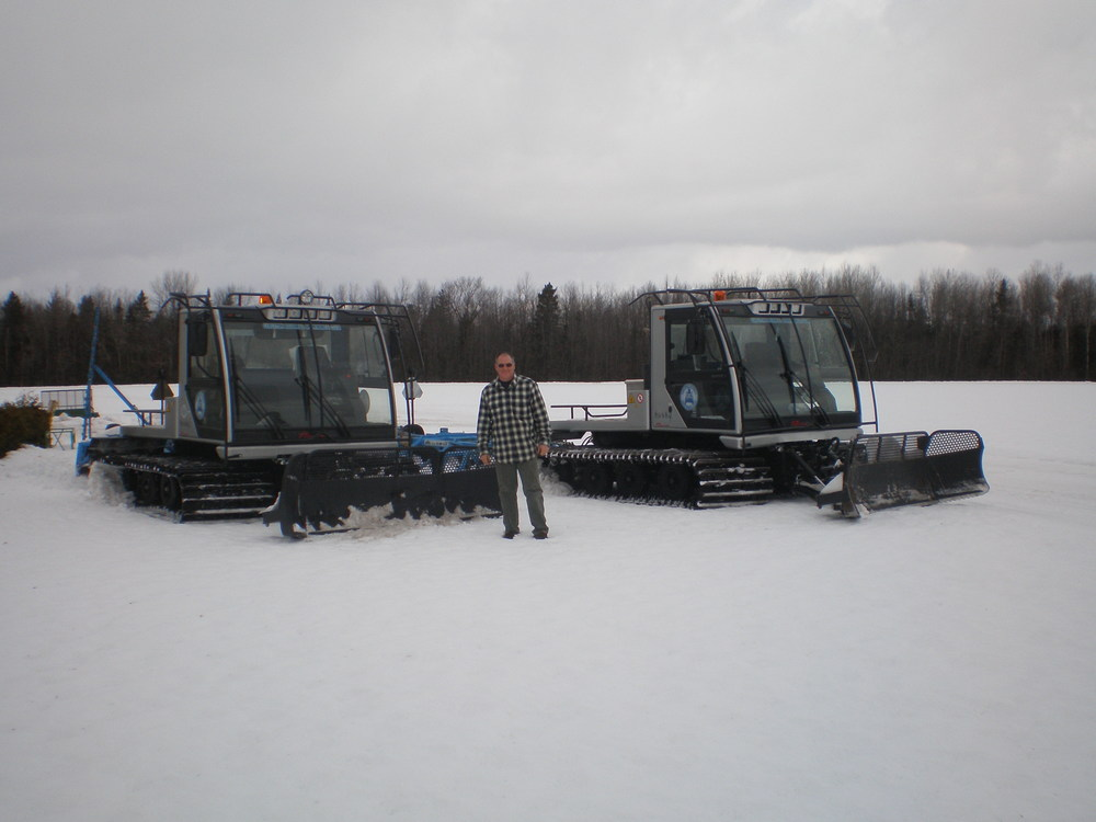 CRSC's two Husky Groomers along with Groomer Operator Doug Champagne.