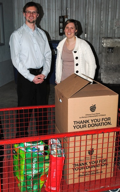 Club President Tim Krause with Ottawa Food Bank's Sarah Burns - CRSC Donations from the 2013 Food Bank Ride for Hunger