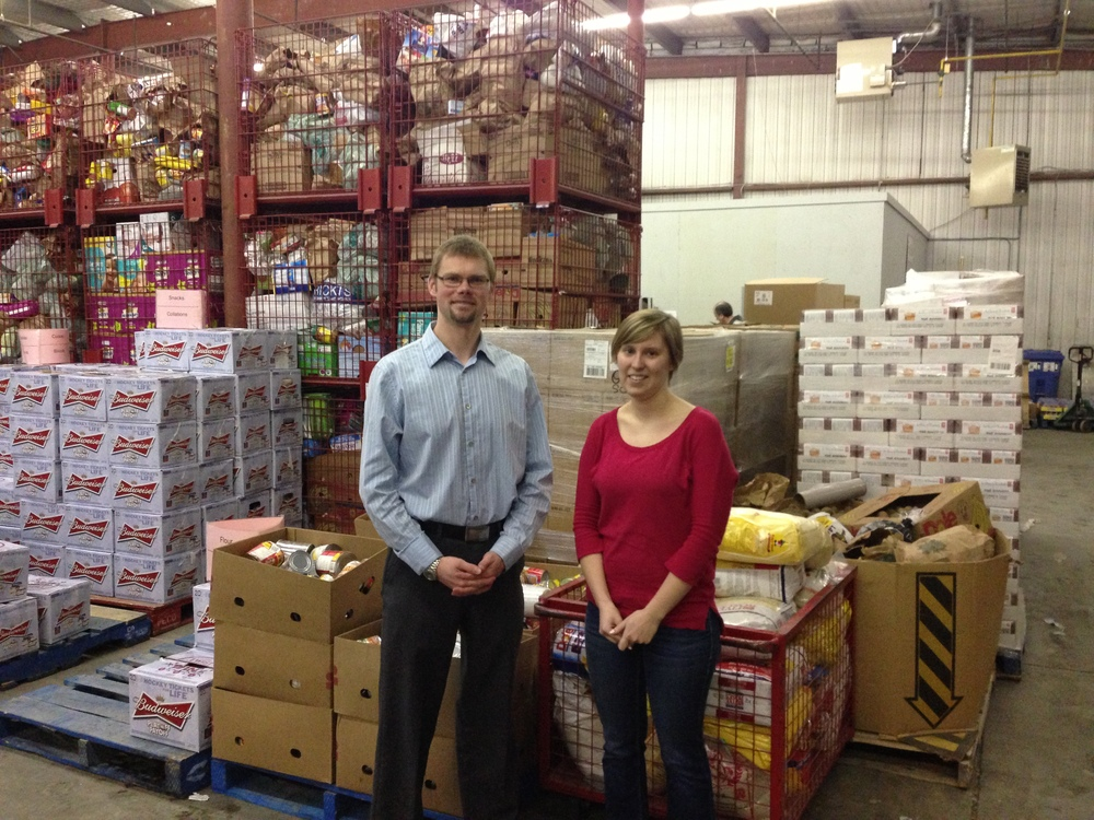 President Tim Krause with Sarah from the Ottawa food bank receiving the donation.
