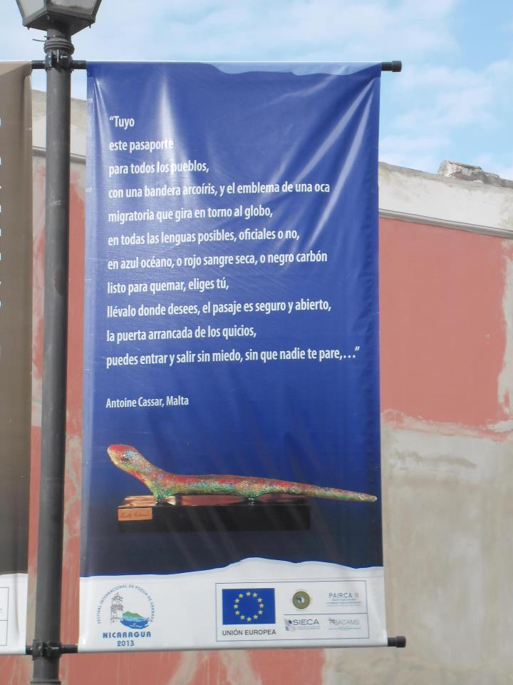 Poster outside the Granada cathedral, Nicaragua. A few lines from the Spanish  Pasaporte  (adapted by Carmen Herrera & Antoine Cassar), accompanied by a picture of a sculpture by  Ernesto Cardenal , evoking a Maltese 'gremxula'.  Festival Internacional de Poesía, Granada, Nicarag  ua