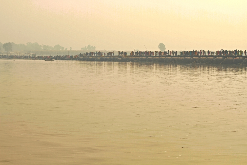 Procession over Floating Bridge on the Ganges River.