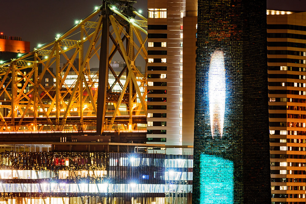Candela is projected on a 50' brick smokestack. Photo by www.8thRulePhoto.com