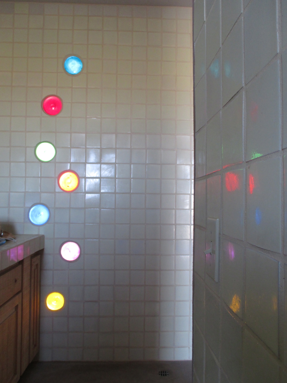 The discs at sunset lighting up the shower room!