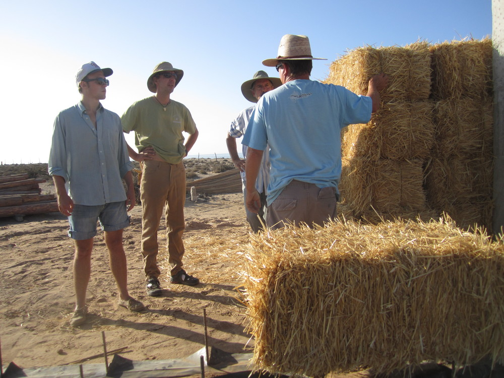 During the summer of 2010, I went to the site to help build the walls. Pictured here is crew member Griff Goins, client Jim Greenleaf, myself and builder Dave Steibel. Dave is instructing us on how to set the bales.