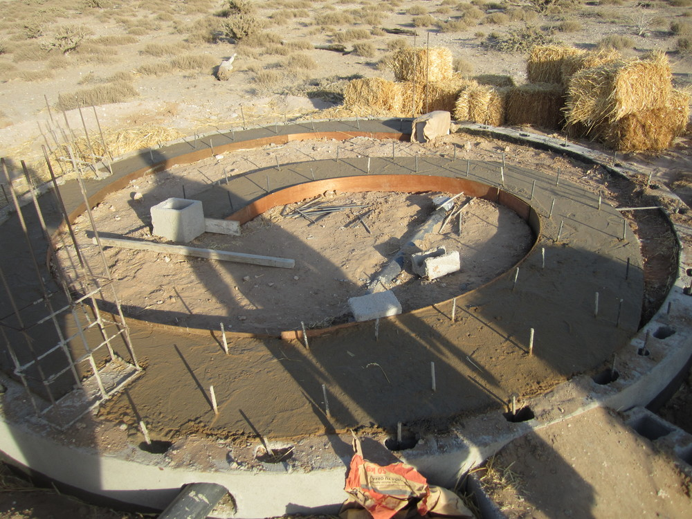The foundation for the spiral outhouse.