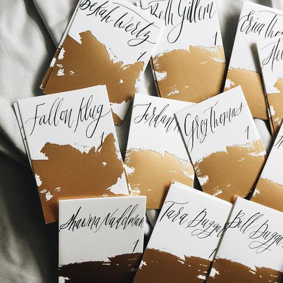 Custom brush strokes turned into gold foil, mixed with a warm navy ink turns something expected into something your guest will treasure forever.  Sarah Ingram