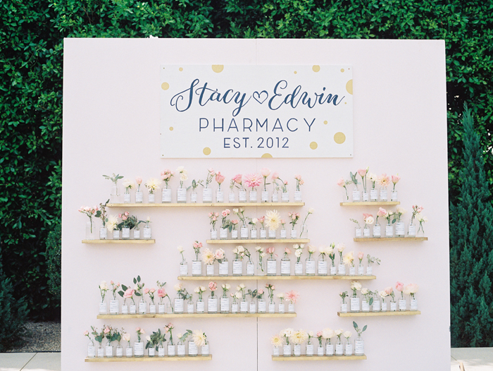 Stacy and Edwin are both pharmacists, so naturally it made sense to include a few fun details that were a nod to the bride and groom's career. Not only is this installation a practical guide for the guests, it also just looks great. Grey Likes Weddings