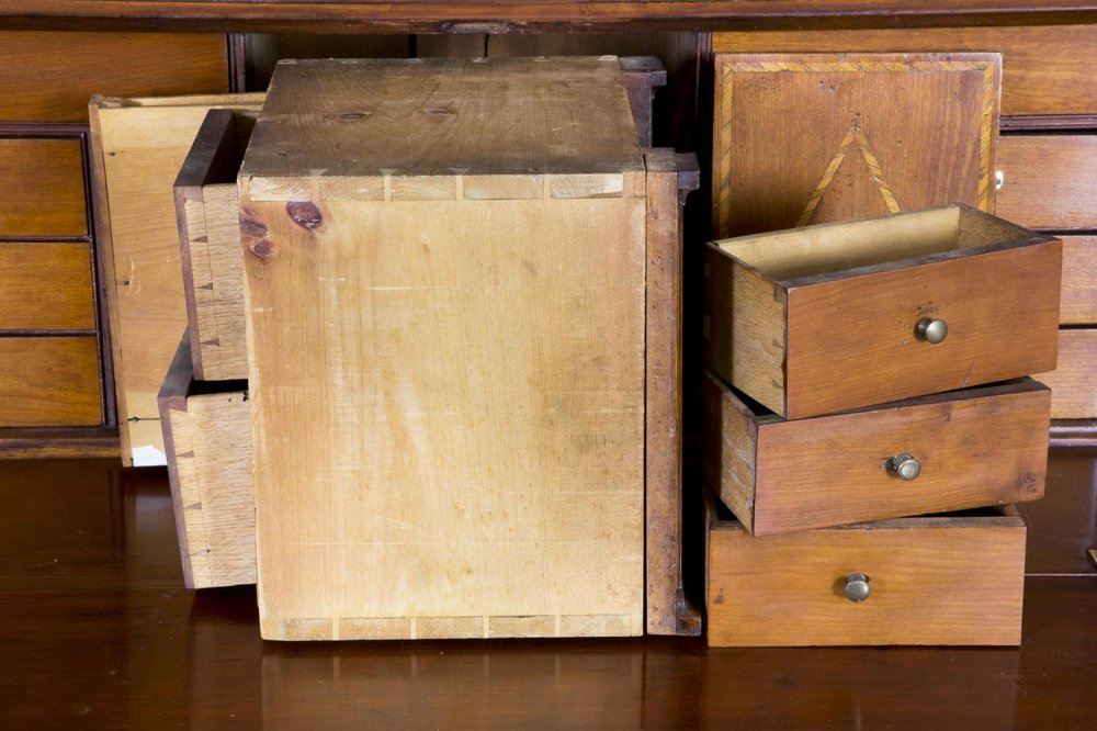 Tiny hidden compartments in an 18th century desk