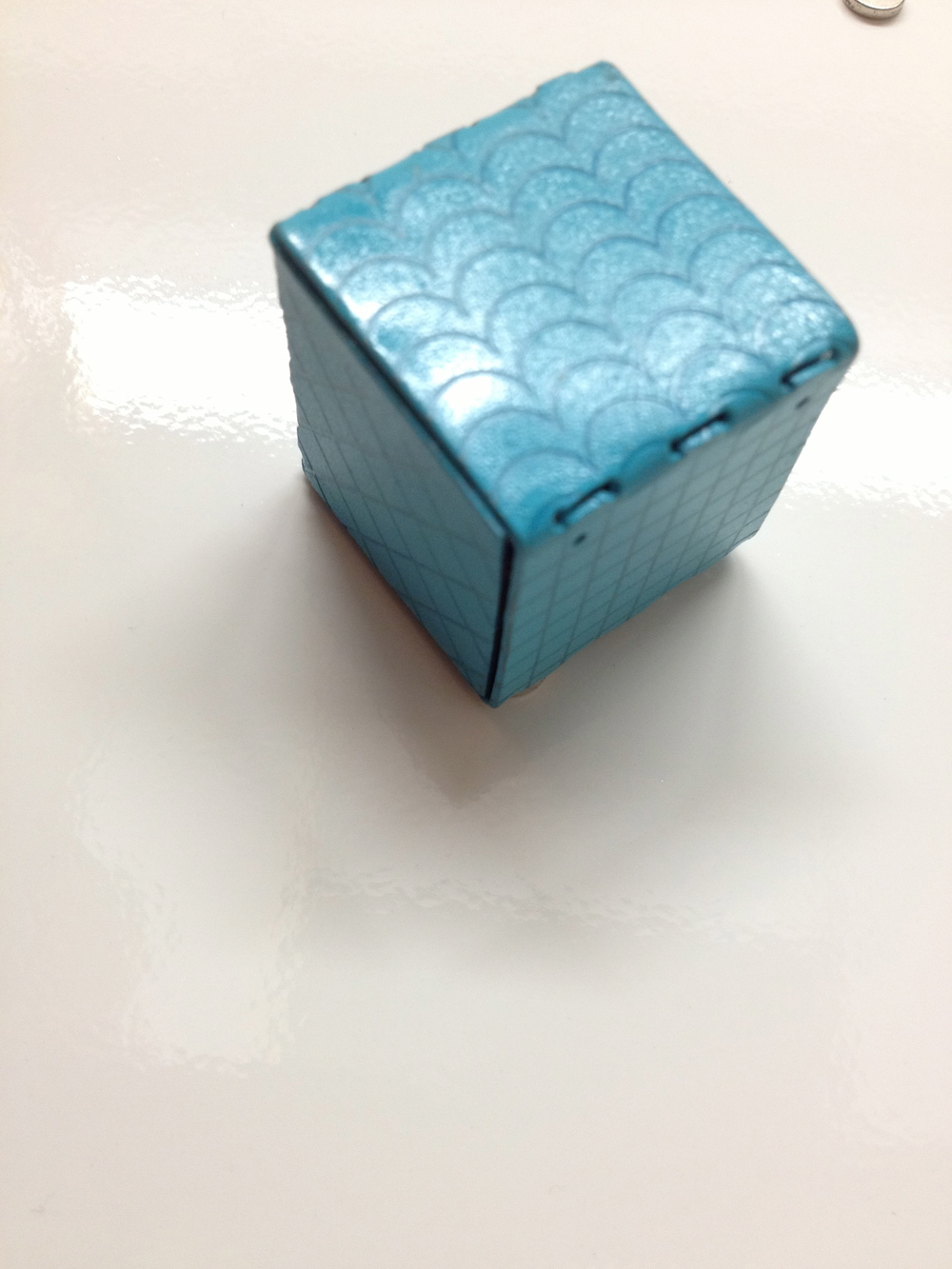I made this cube out of steel, spray painted it, and then etched a different pattern on each side