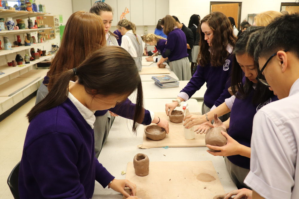 Students making ceramic bowls for the Empty Bowl Event