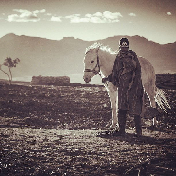 "Perspective: ""I am twenty years old and my horses name is Tobake. I bought him in the neighboring village of Hatjobe two years ago."" Mphale is humble man, with great passion in taking care of animals and farming. I had just finished portraying him on his horse when we began to talk and got to know each other. ""He is beautiful. How much did you have to pay for him?"" I ask. ""He cost me 500 Rands (350 NOK, 50 USD)."" His eyes lit up with great pride. ""Really, 500 Rands?"" I was astonished how cheap you could actually get a beautiful horse like this. ""So how long did you have to work to save up the money for your horse?"" I ask him. He looks at me and answers without hesitation or the need to calculate. ""One year."""