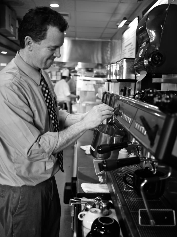 Manager Matthew Clark preparing a beverage for a customer.