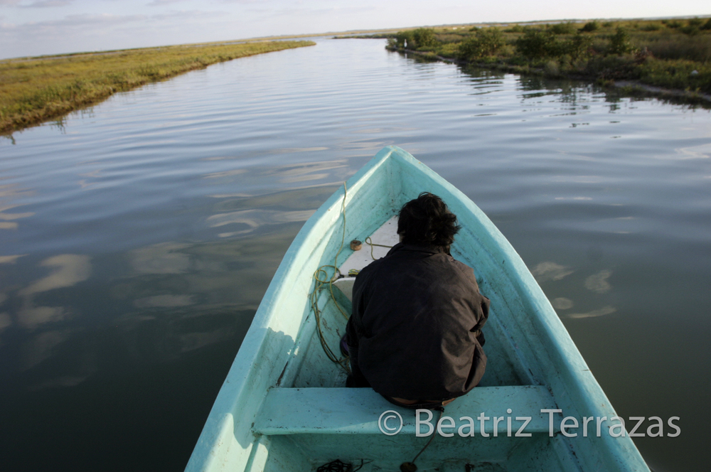 A Mexican fisherman floats one of the channels branching out from the Rio Grande just before it empties into the Gulf of Mexico.