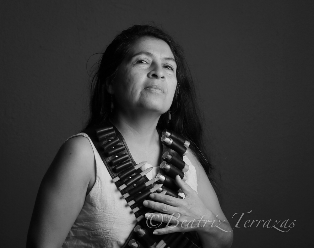 Tammy Melody Gomez is a Fort Worth poet, author and activist. Here, she models a set of bandoliers filled with an artist's ammunition--pencils and lipsticks.
