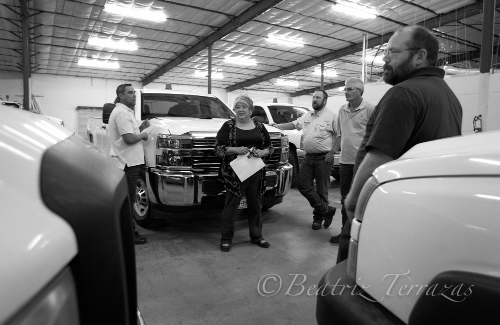 Rosa in The Rios Group shop discussing the fleet with her team.