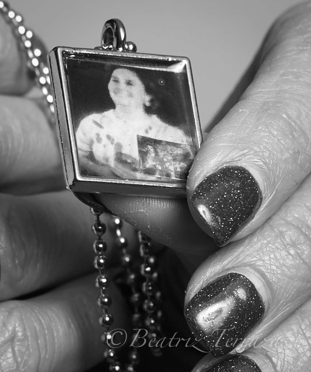 Susie sometimes wears a pendant with her mother's photo on it. I attended a concert in which Susie's son performed with his high school band, and Susie wore the locket as a way to honor her mother's own music, as well as to have her present at the performance.