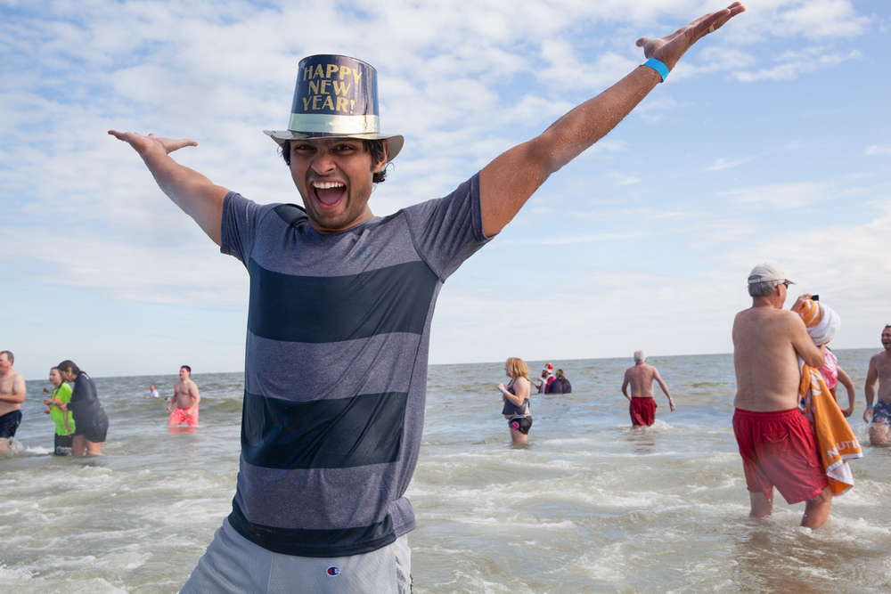 Joshua Galemore for Savannah Morning News - An attende runs back to the beach after being in the ocean for the Tybee Polar Plunge in celebration of the new year.