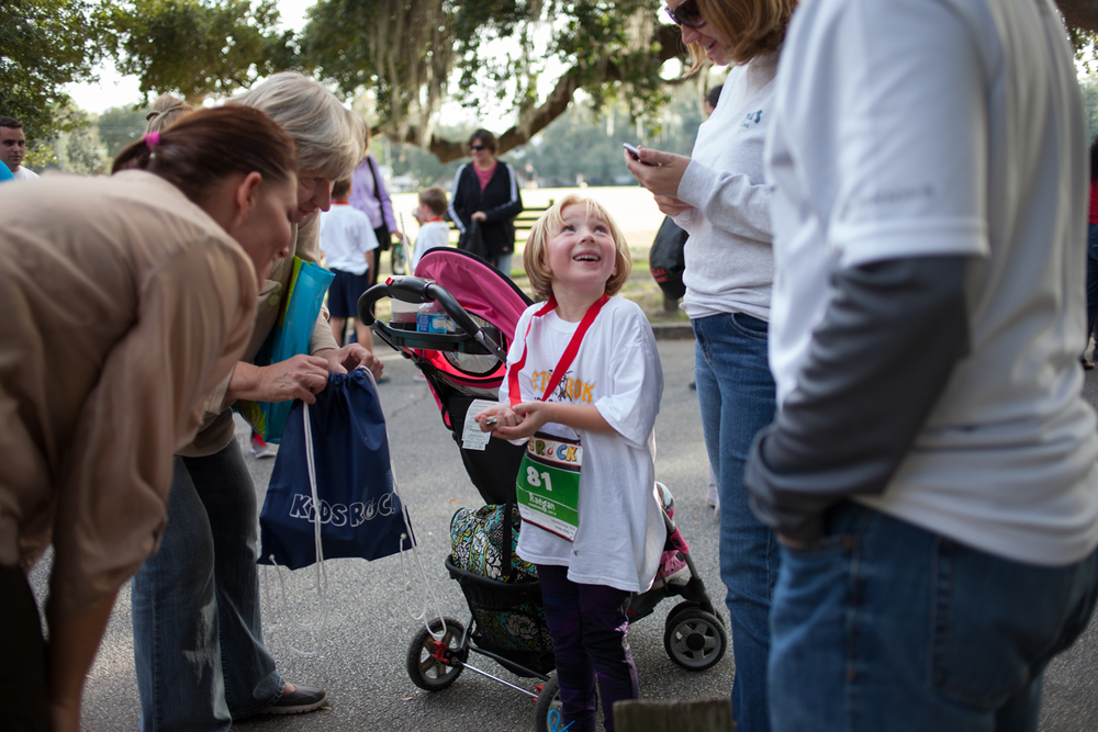 Joshua Galemore for Savannah Morning News - Raegan Massey, a six year old from Bermingham, AL, celebrates her run with her aunt (Tricia Russell), grandmother (Pat Russell), mom (Meredith Massey), and dad (Chris Massey.)