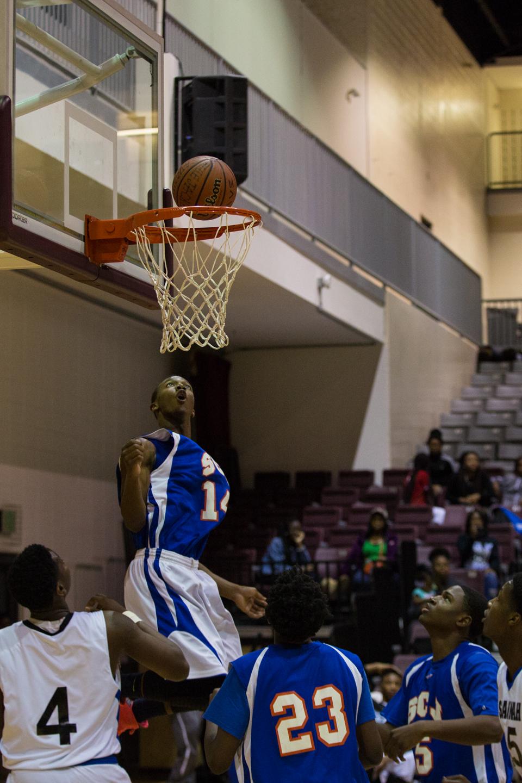 Joshua Galemore for Savannah Morning News - Rajah Bush, from Johnson High School, scores a basket during a game against Savannah High School at the Armstrong University Arena.