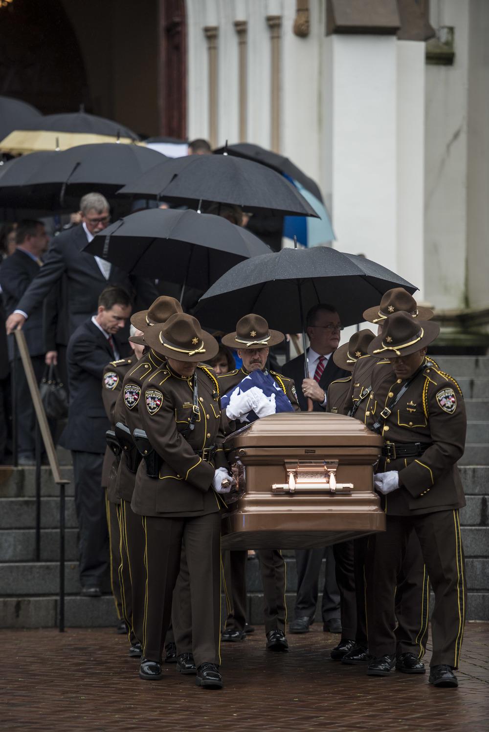 The honor guard leaves the Cathedral of St. John the Baptist during the funeral for former Sheriff Al St Lawrence.
