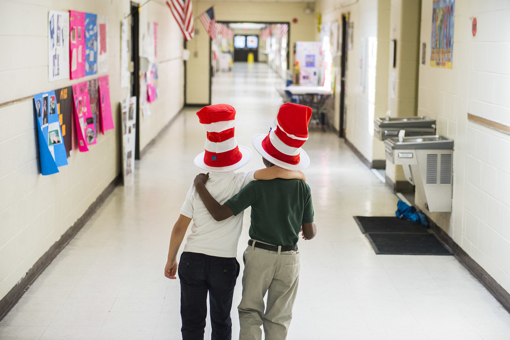 James Waller and Marquis Williams, both students in the Love on a Leash mentoring program, walk to the water-fountain at Gould Elementary in-between reading to Pre-K and Kindergarten classes.