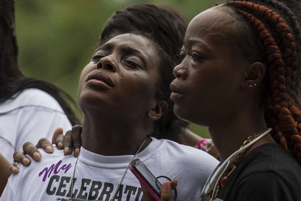 Shamika Washington sheds a tear while members of Yamacraw Village and the surrounding community comfort her during a celebration of life for her daughter who died a few days earlier after taking her own life.