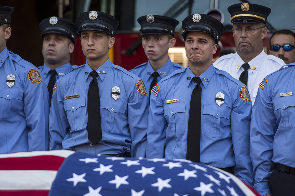 Members of Savannah Fire Department stand by the casket of Master Firefighter Michael Curry during a traditional firefighter memorial at Fire Station #3. MFF Curry died November 19, 2016 from an aortic aneurysm while assisting in rescuing people who fell in the Savannah River after a dock collapsed on River Street.