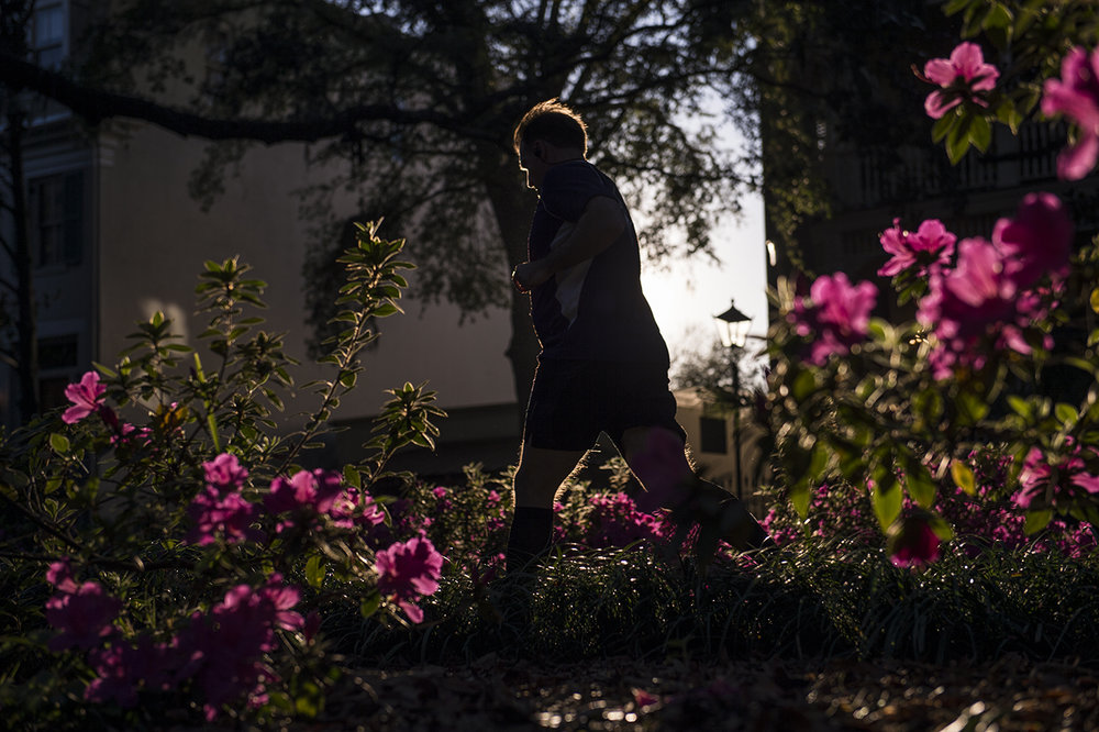 A man runs around Forsyth Park Friday afternoon as bushes already begin to fill with flowers. March came in with a record-tying high in Savannah of 86 degrees last Wednesday. Climate change is advancing the onset of spring across the United States, though at different rates in different regions.