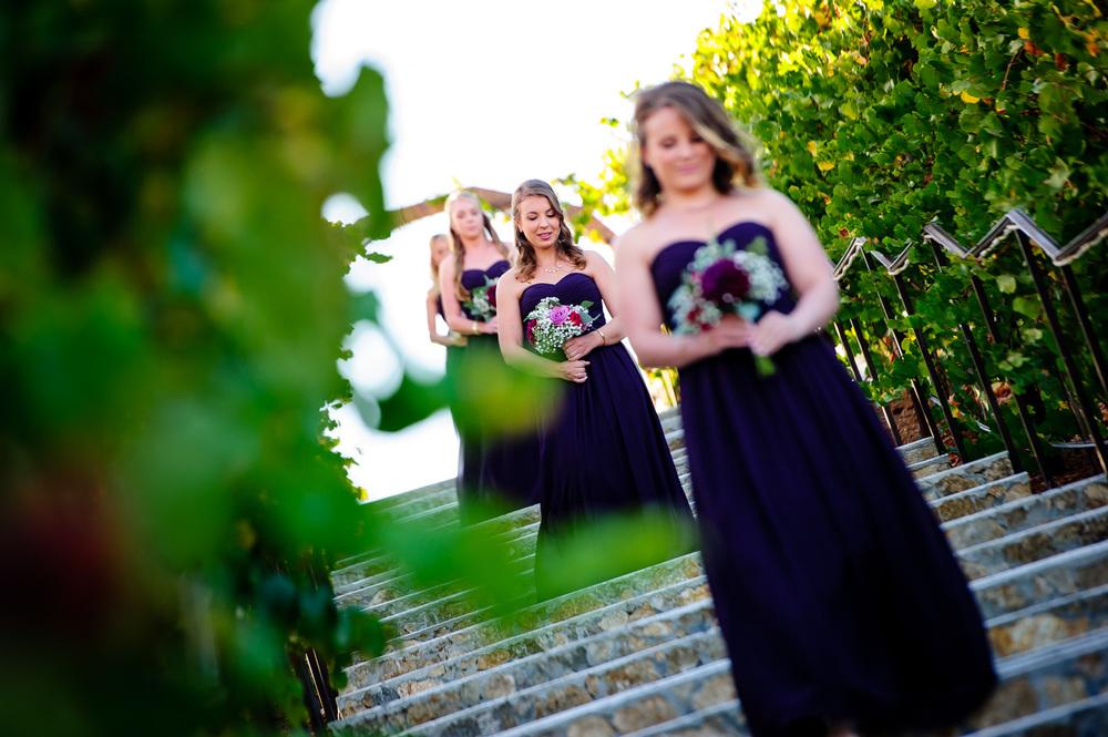 Bridesmaids wearing purple maxi dresses
