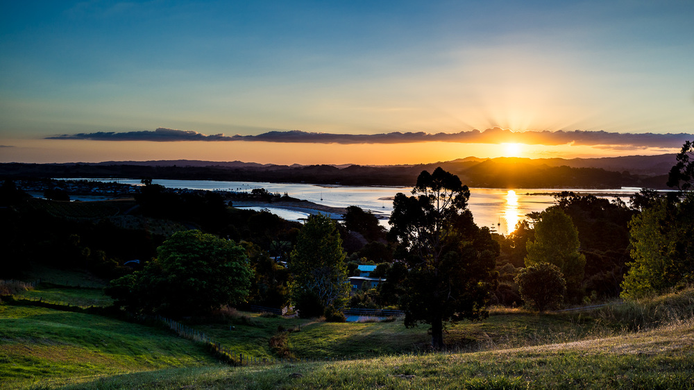 Sunset over Whangateau Bay in New Zealand,