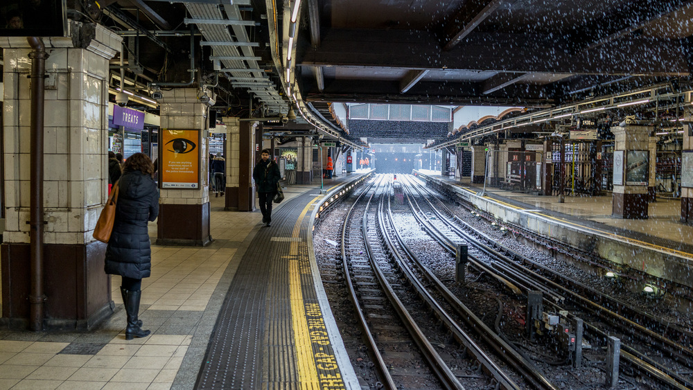 Snow falls on the tracks of the Metropolitan line at Baker Street Tube station in London