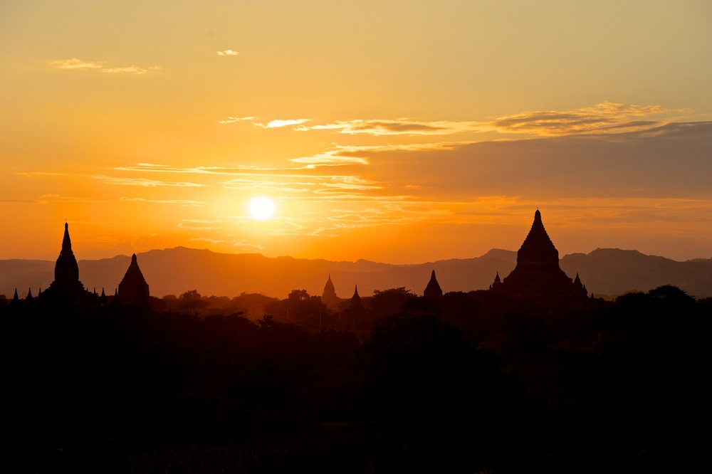 The sun rises over the temples in the valley of Bagan, Myanmar, December 2011.