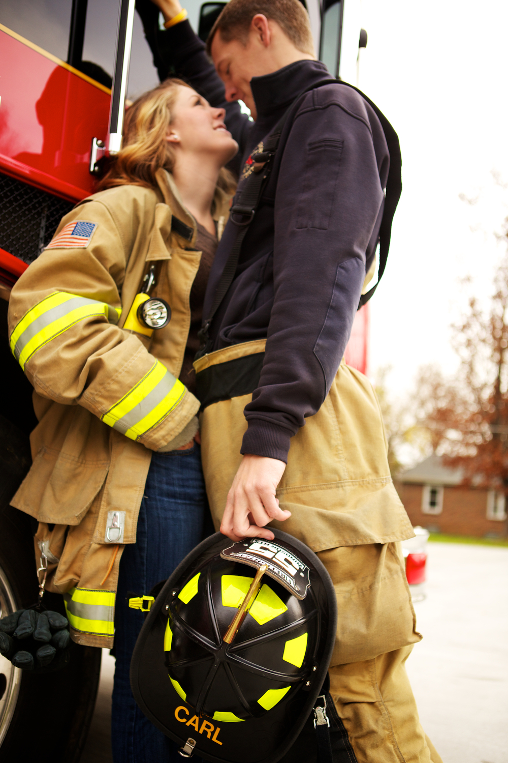 I owa Fire Station in Windsor Heights. Engagement session at the fire station with a fire fighter.