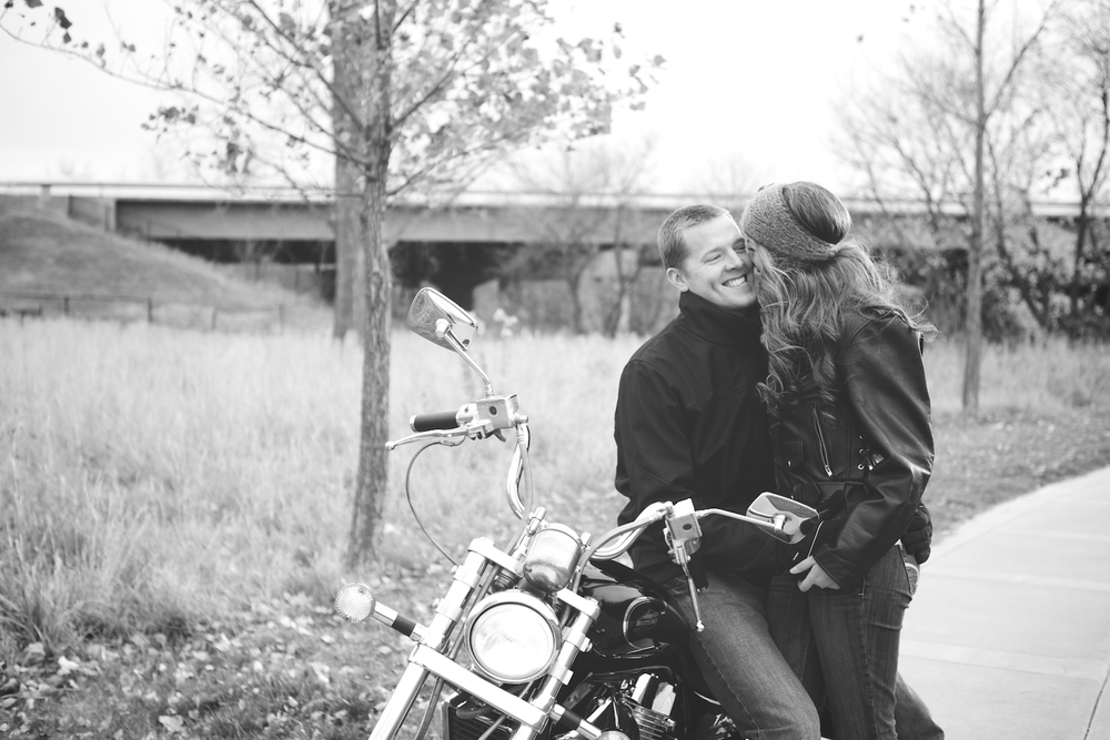 I owa Fire Station in Windsor Heights. Engagement session at the fire station with a fire fighter. Engagement session with motorcycle. On a ride with a motorcycle.