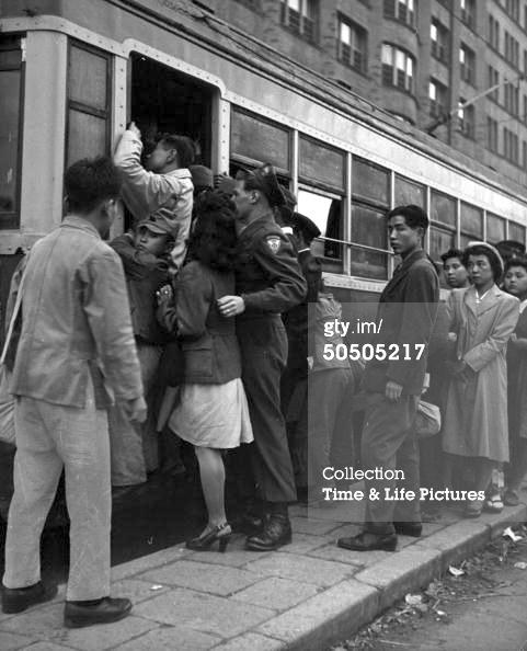 Couple Boarding Tram.jpg