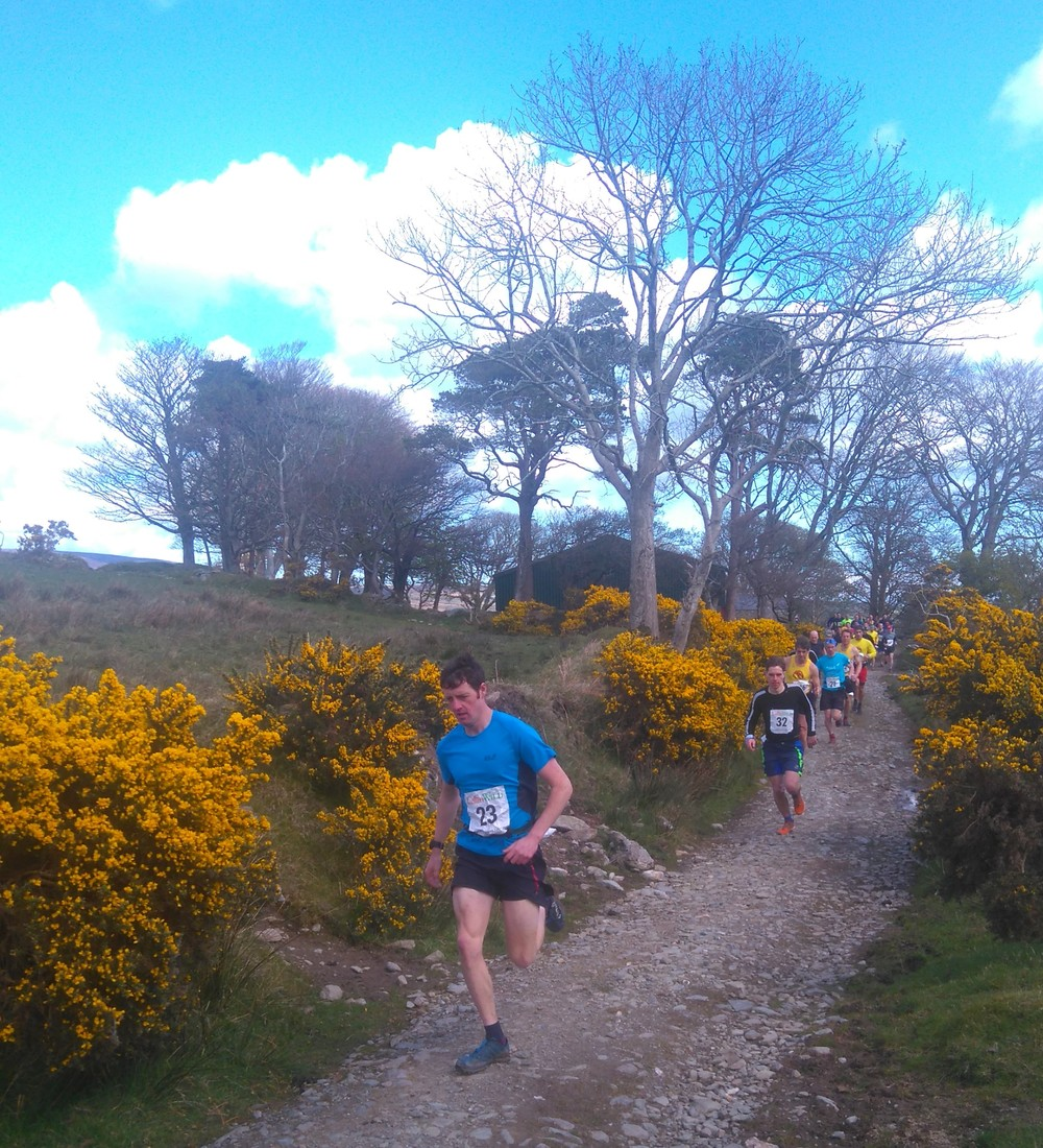 eventtual winner Ben corkill (23) leads them off in the start of the 2016 james coulson laxey fell race