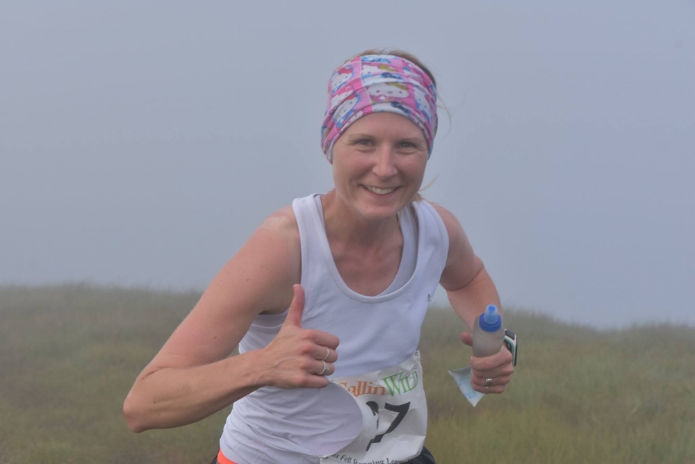 Kirsty arnold approaches the summit of a misty north barrule (Photo: murray lambden)