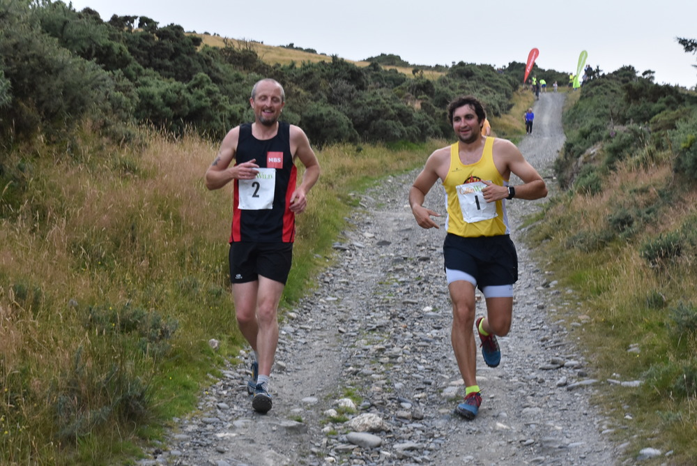 1st Vet and 4th Overall Jim Macgregor with Svetlin Krastev returning from the finish on Sky Hill. Photo by Murray Lambden (more photos at http://isleofman.in/killermile2016)