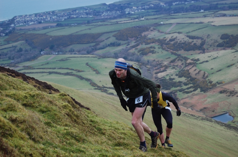 It's a bit steep fella! Pete Bradley and Paul Sykes battle it out on the infamous slope of Slieau Freoaghane. Both runners are currently injured but hopefully we'll see them return on march 10th!. (Photo courtesy of Murray Lambden)