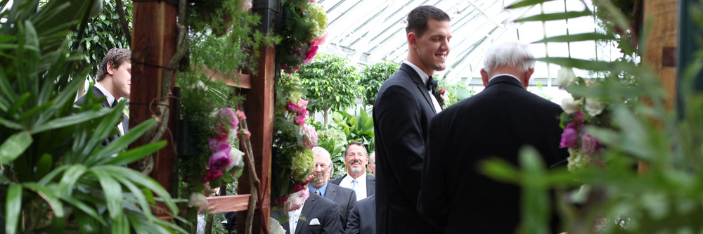 See the man smiling in the background?   That's the Father of the Groom.  Isn't he the happiest man that you've ever seen!?