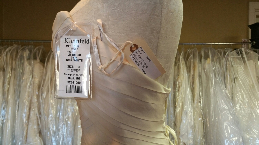 "check out the price!!! They have racks and racks of gowns for sale. Designer samples ""for a song""."