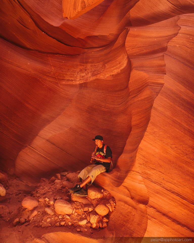 Navajo playing flute in Lower Antelope Canyon