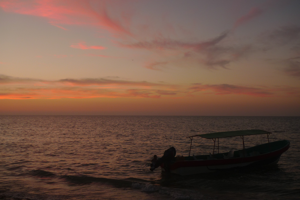 boat silhouette and pink clouds.jpg