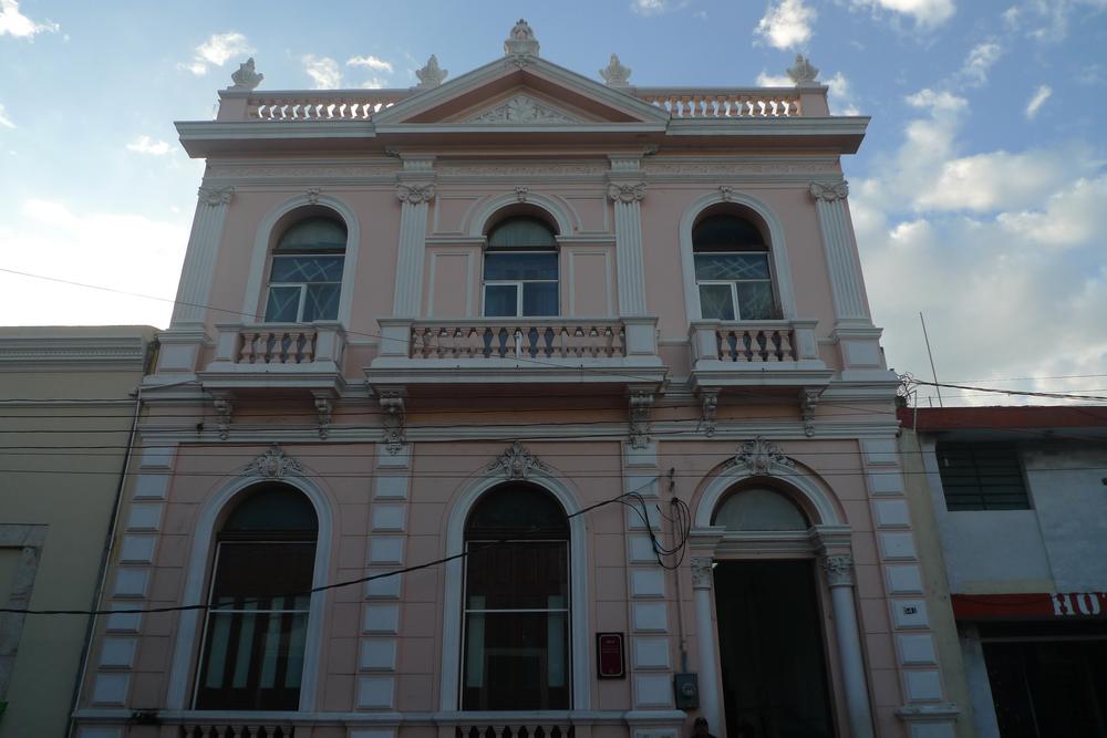 pink facade corinthian pilasters.jpg