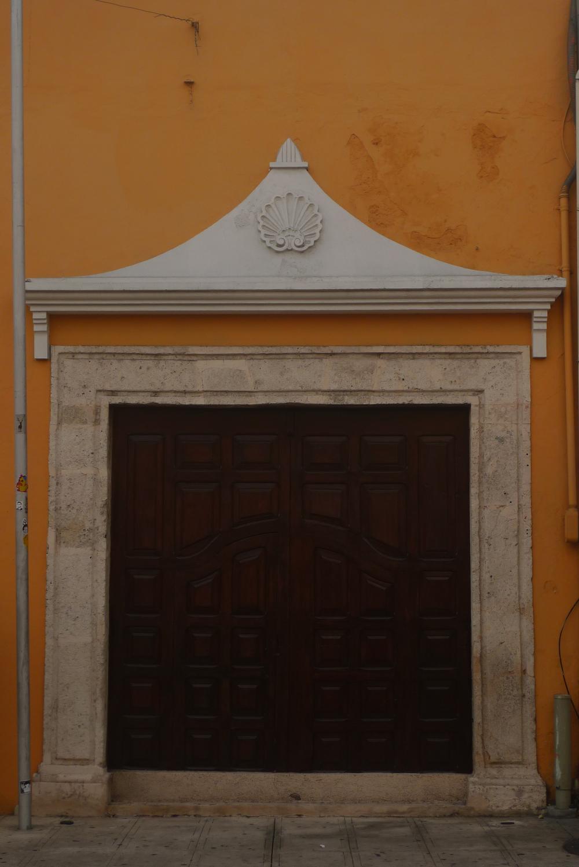 shell doorway in orange facade.jpg