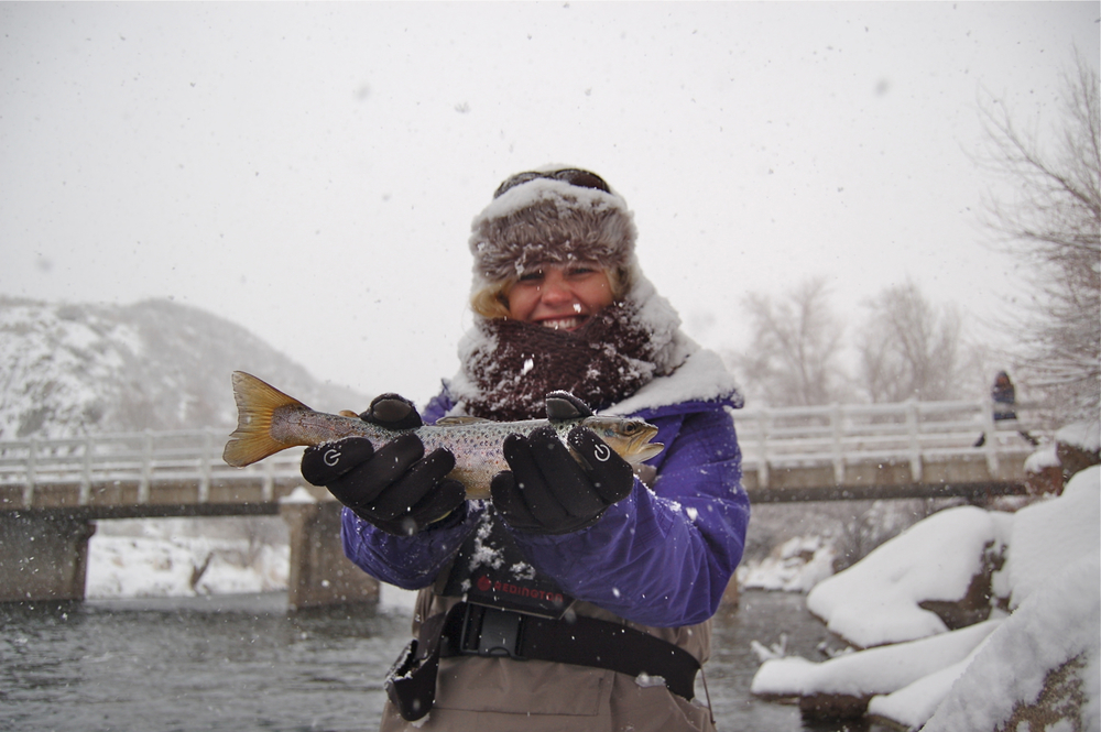 Casey with a brown trout on the middle Provo River